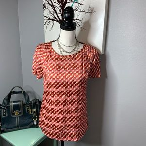 Tory Burch size 6 Rust colored blouse logo on top